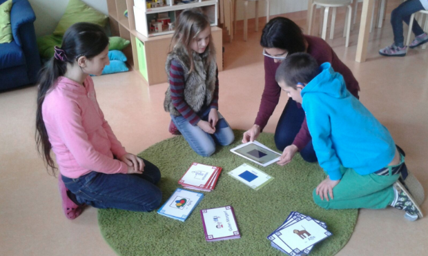 deaf children using Augmented Reality to improve their reading skills in a classroom