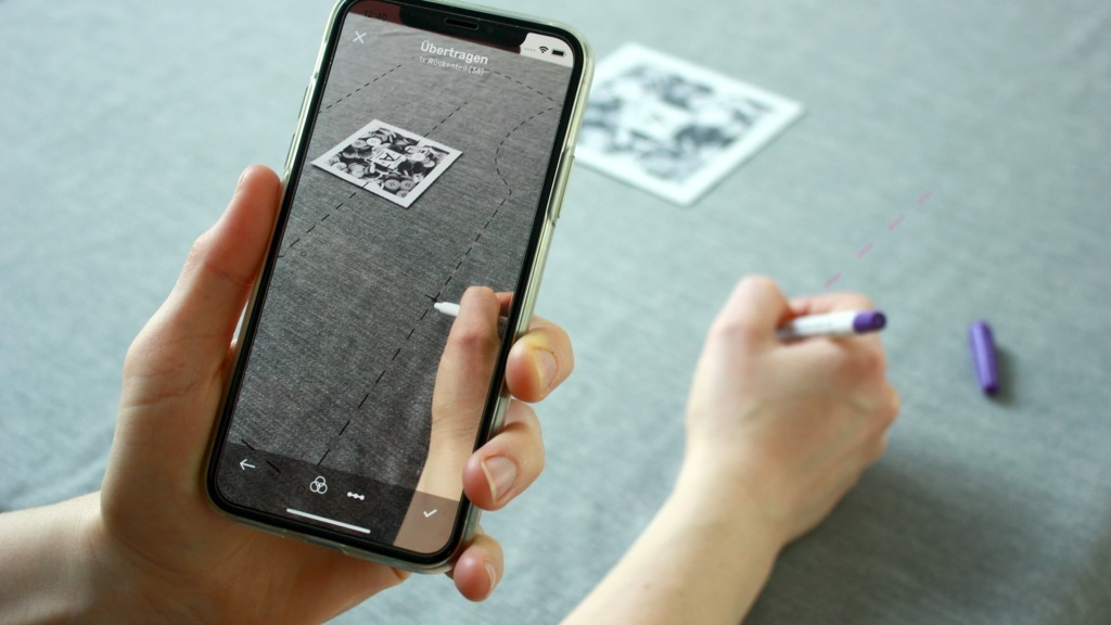 image target locks and anchors augmented reality sewing patterns to fabric